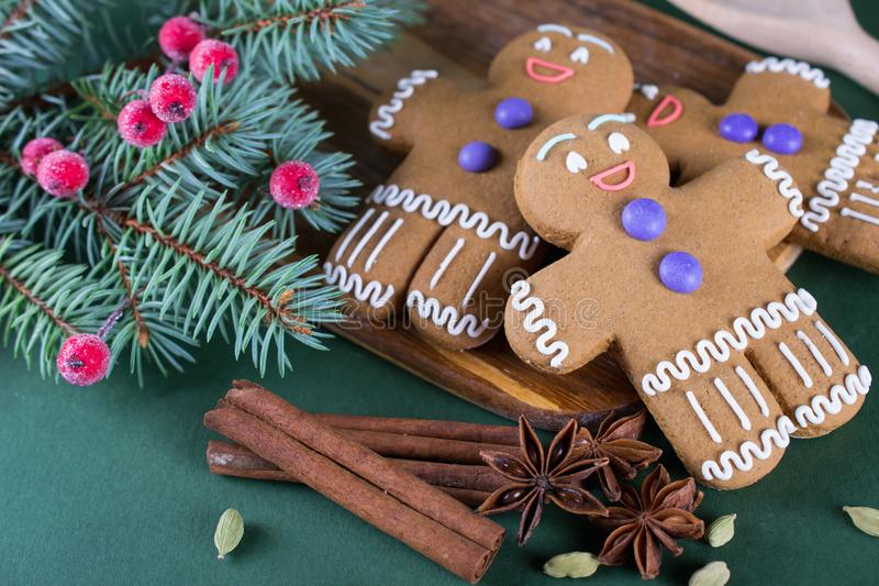 Christmas and holiday baking . Ginger men cookies with decor. On green background stock image