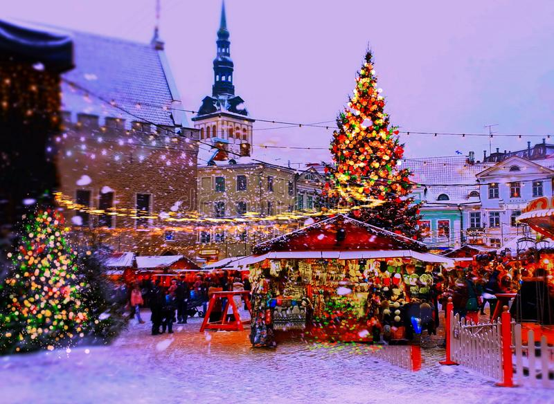 Christmas holiday in the city new year in Tallinn old town square Christmas tree decoration light market place Estonia. Tallinn snowflakes Christmas Holiday In royalty free stock photography