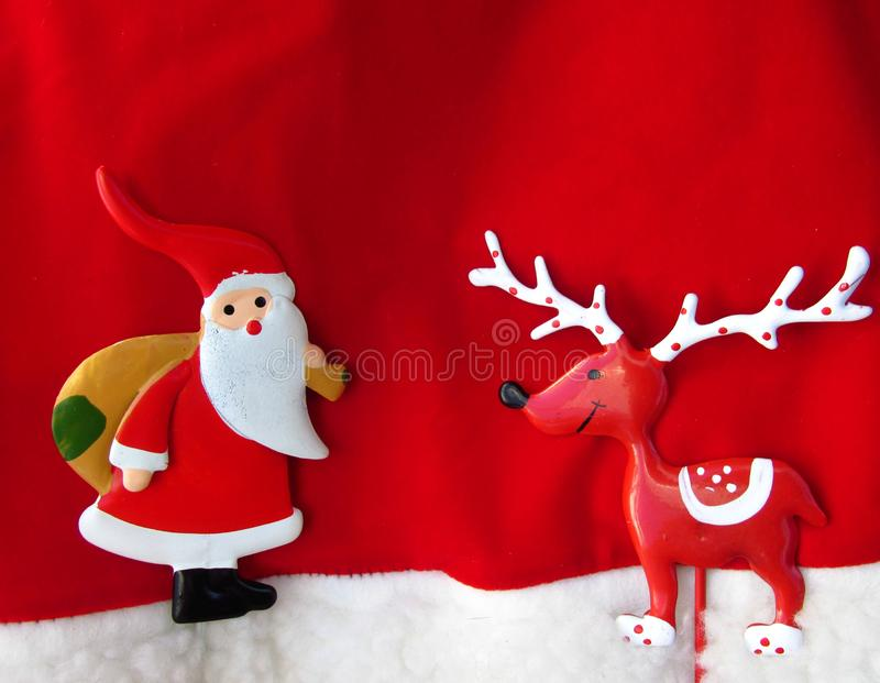 Christmas season theme, with Santa Claus and reindeer. Christmas holiday composition top view. Christmas background stock photos