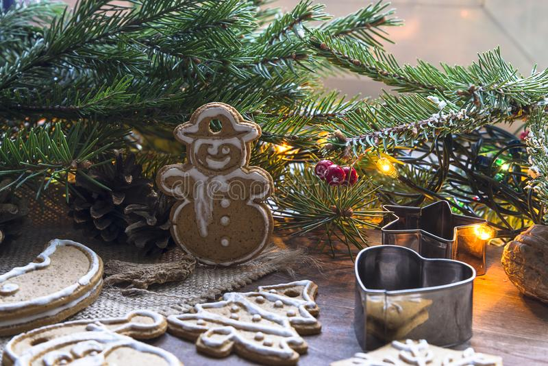 Christmas holiday composition. Biscuits with gingember, various of mulles and christmas tree with lights. Biscuits with gingember, various of molds and christmas royalty free stock photo
