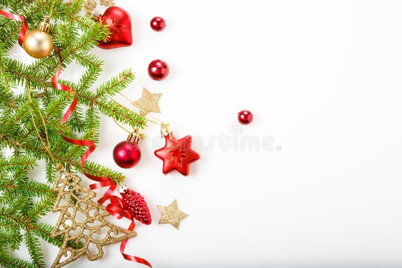 Christmas holiday composition. Festive creative pattern, xmas red decor holiday ball with ribbon, snowflakes, christmas tree on wh stock photos
