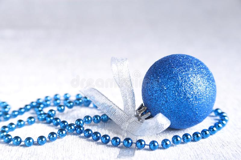 Christmas or holiday composition with blue silver balls on billowy feathers with snow and snowflakes. stock photography
