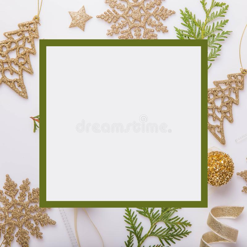 Christmas holiday composition. Festive creative golden pattern, xmas gold decor holiday ball with ribbon, snowflakes, christmas tr royalty free stock images