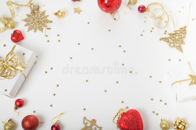 Christmas holiday composition. Festive creative golden pattern, xmas gold decor holiday ball with ribbon, snowflakes, christmas tr. Christmas or Ner Year holiday stock image