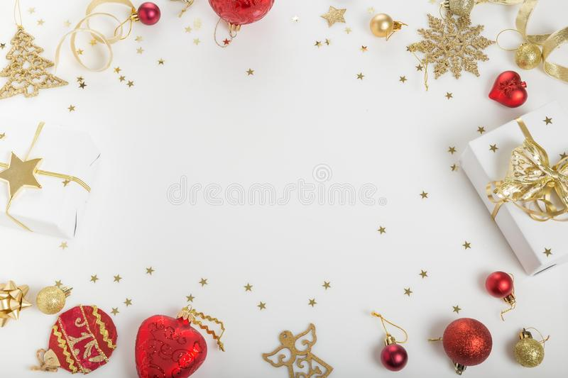 Christmas holiday composition. Festive creative golden pattern, xmas gold decor holiday ball with ribbon, snowflakes, christmas tr. Christmas or Ner Year holiday royalty free stock image