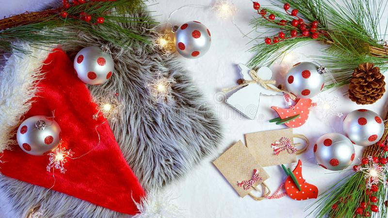 Christmas holiday concept with baubles and decorations scattered on table. stock photos