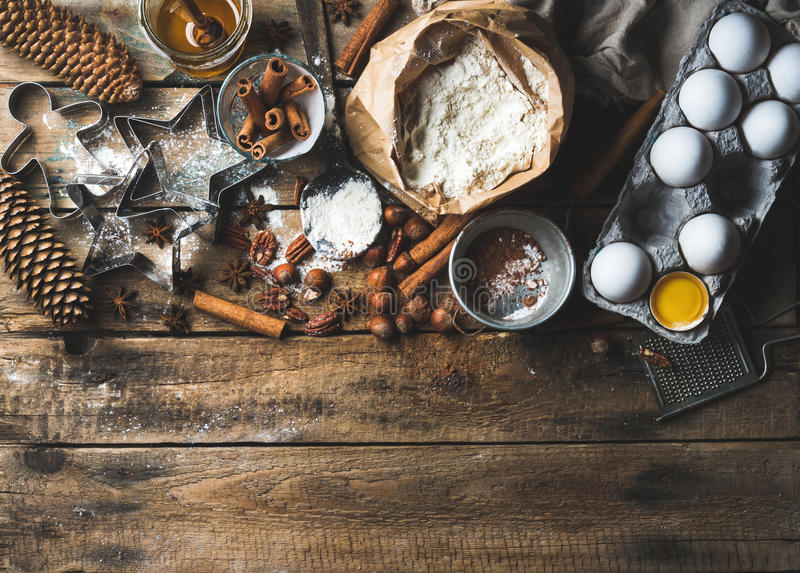 Christmas holiday cooking and baking ingredients on rustic wooden background royalty free stock photos