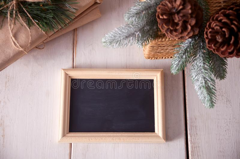 Christmas holiday decorations with blackboard on white background royalty free stock image