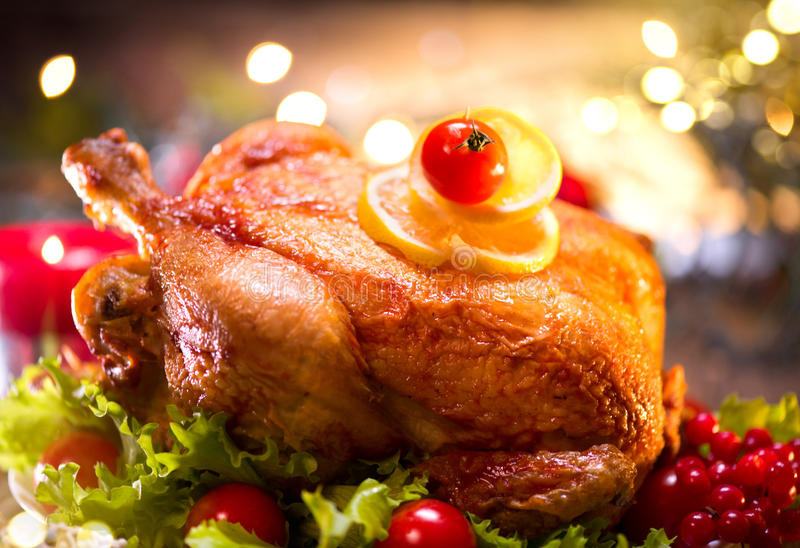 Christmas holiday family dinner. Decorated table with roasted turkey stock photo