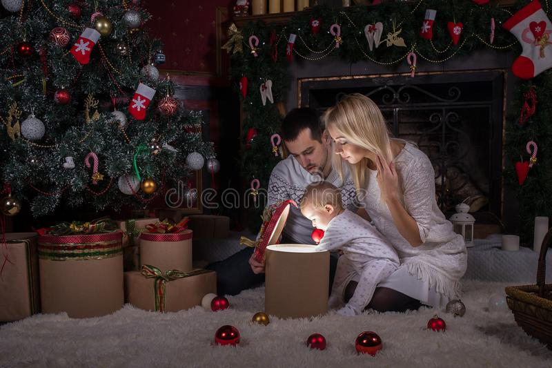 Christmas holiday. Family opens the magic box with gift. Box full of magic surprises and secrets Happy family concept royalty free stock photos