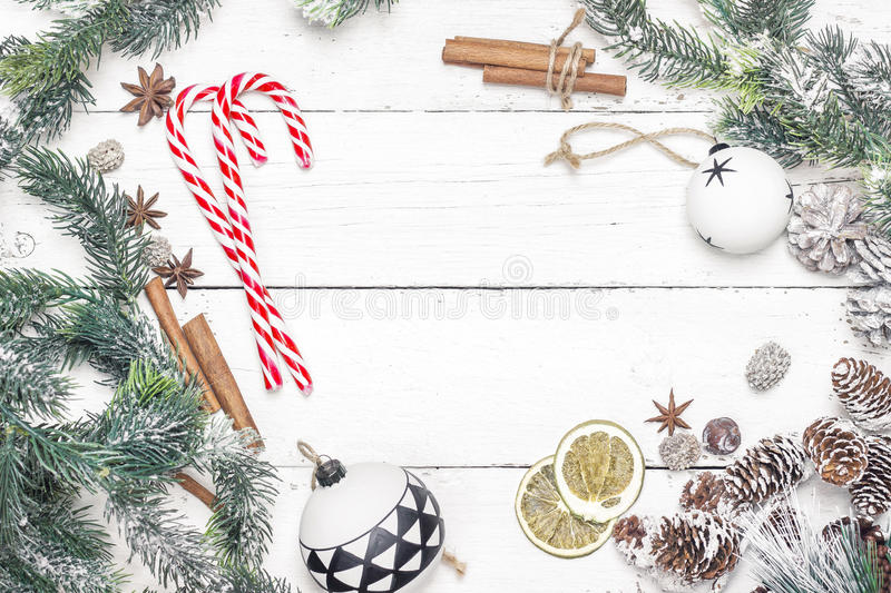 Christmas holiday frame with candy canes, fir branches and chris stock photography