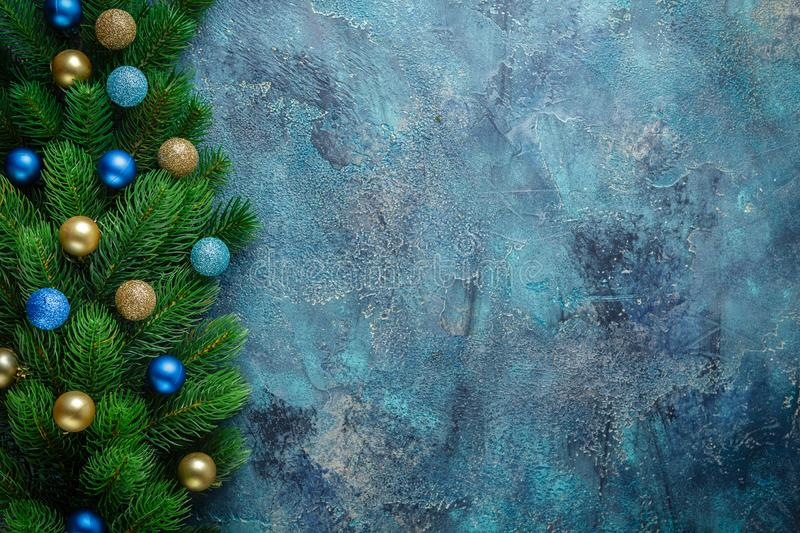 Christmas holiday frame with festive decorations blue and gold baubles on old blue background. Christmas background with copy royalty free stock photography