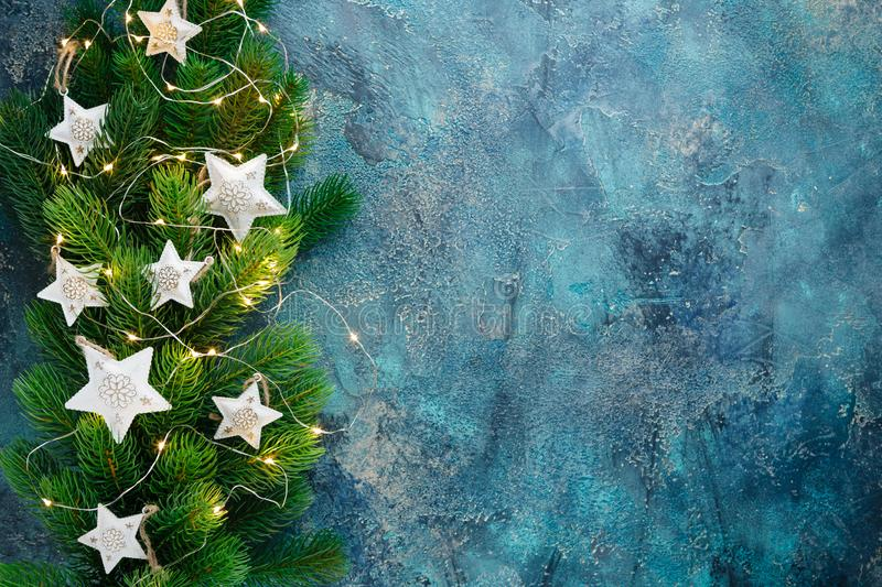 Christmas holiday frame with festive decorations - white metal hearts and old pjcket wathes on old blue background. Christmas stock image