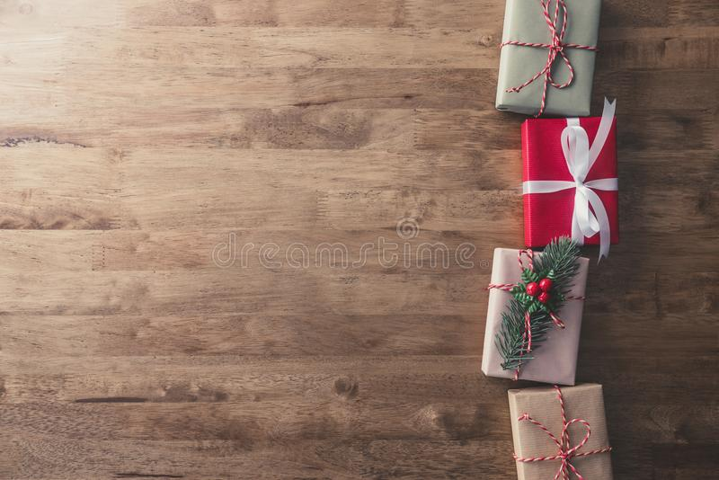Christmas holiday gift boxes on wood table, border design background. Christmas holiday gift boxes on wood table, top view border design background with copy stock photos
