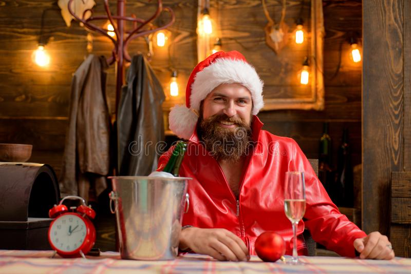 Christmas holiday. Lonely on christmas eve. Happy new year. Time to drink. Manly brutal santa leather jacket. Brutal. Santa claus. Man bearded hipster santa royalty free stock images