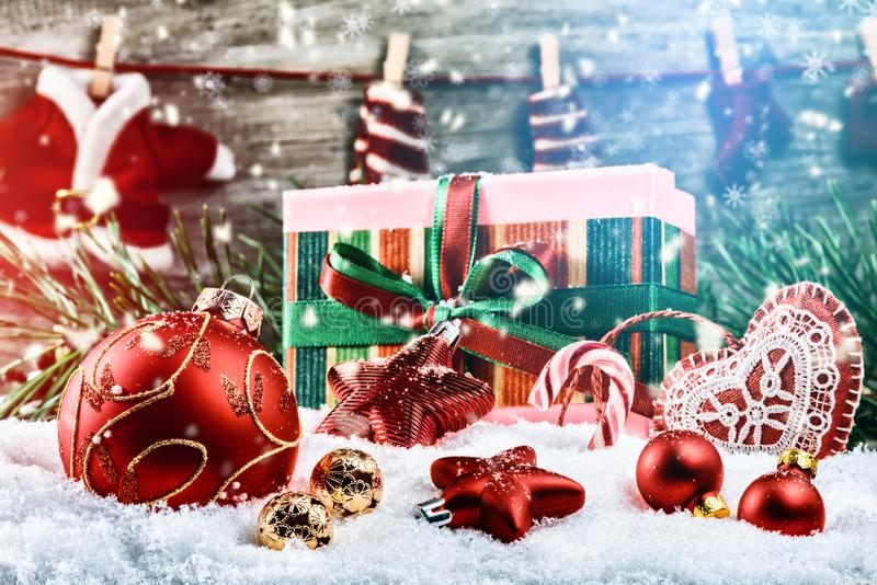 Christmas holiday setting with presents and baubles royalty free stock images