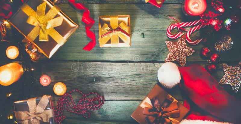Christmas holiday vintage background. Gifts and decorations. On green wooden table royalty free stock image