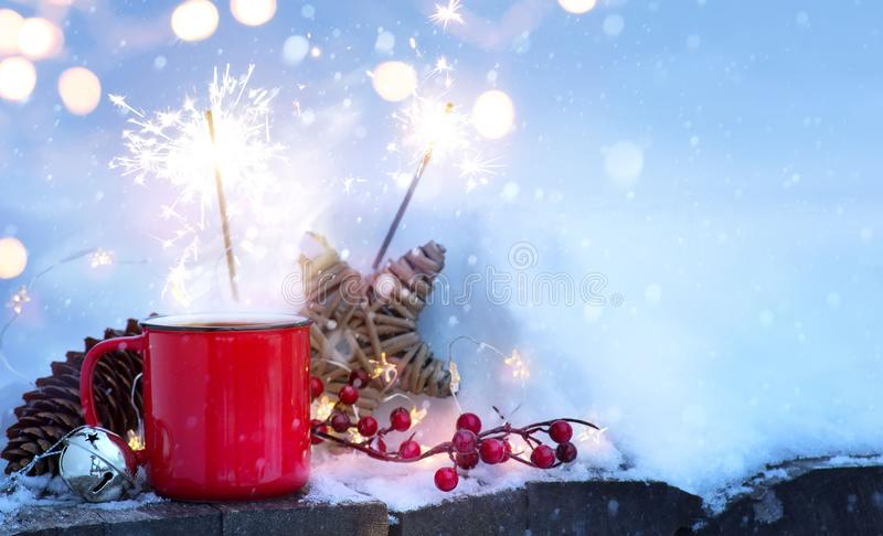 Christmas holidays background; winter hot drink. And Christmas holidays Light on snow royalty free stock photo