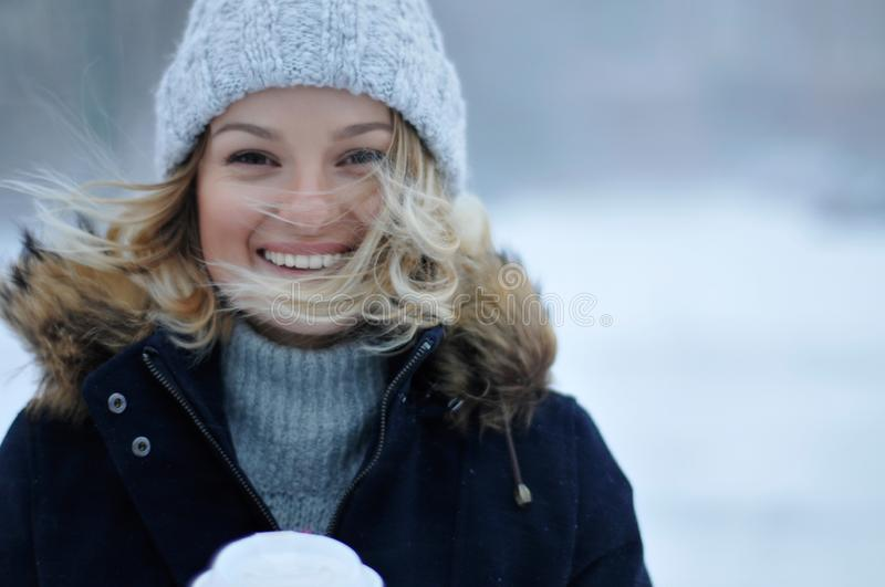 Beautiful woman in winter clothing with cup of hot coffee outdoor royalty free stock images