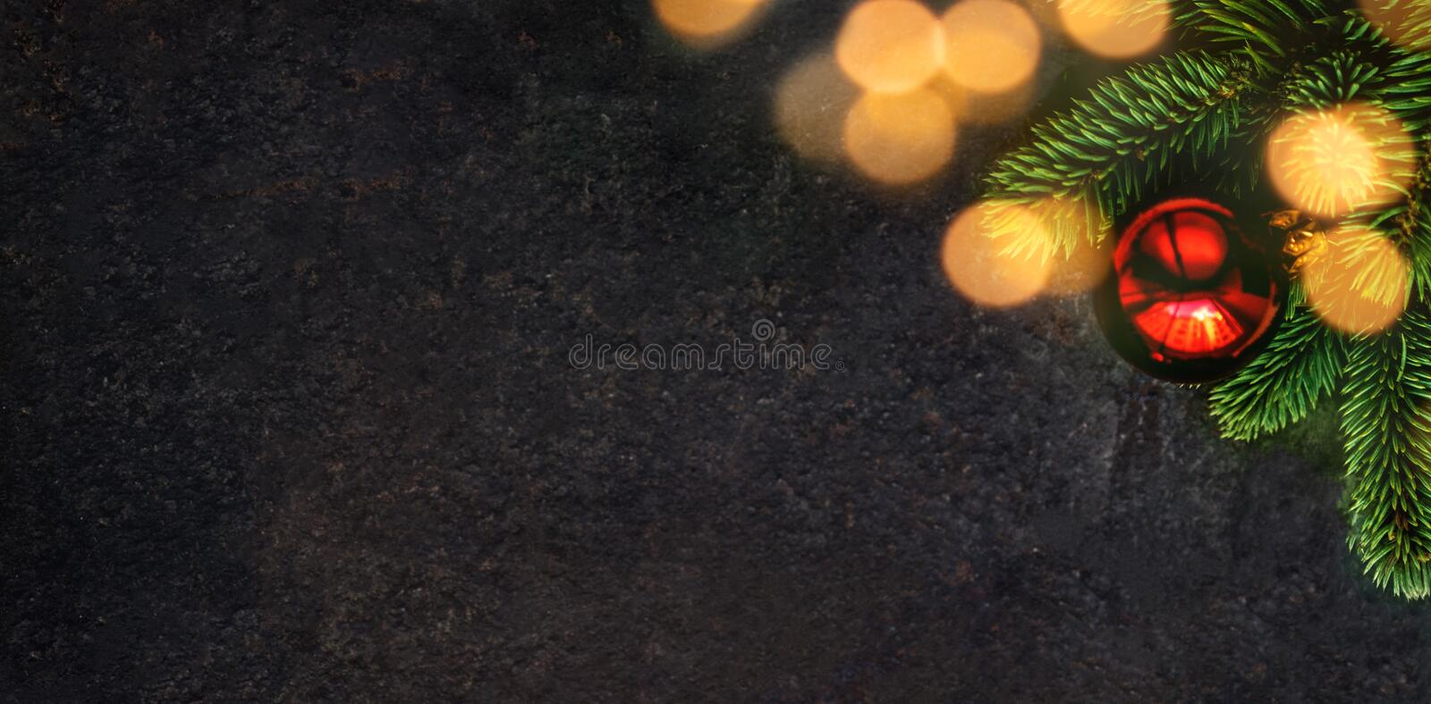 Christmas holidays composition on black background with fir tre royalty free stock image