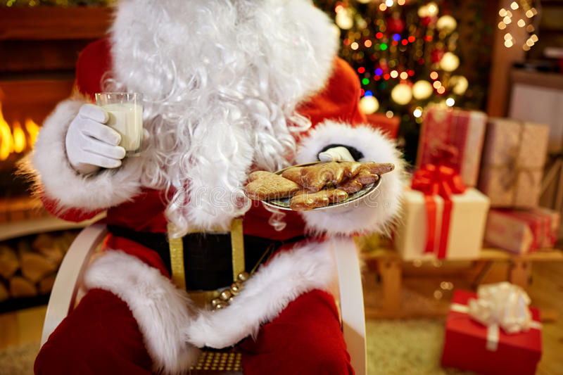Christmas, holidays, food, drink and people concept - of Santa C stock images