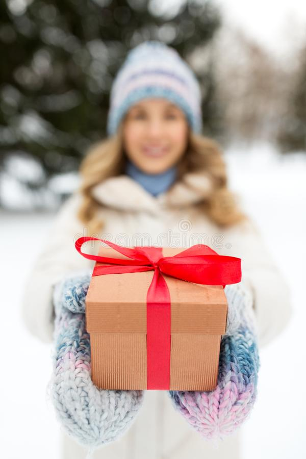Close up of woman with christmas gift in winter stock photo