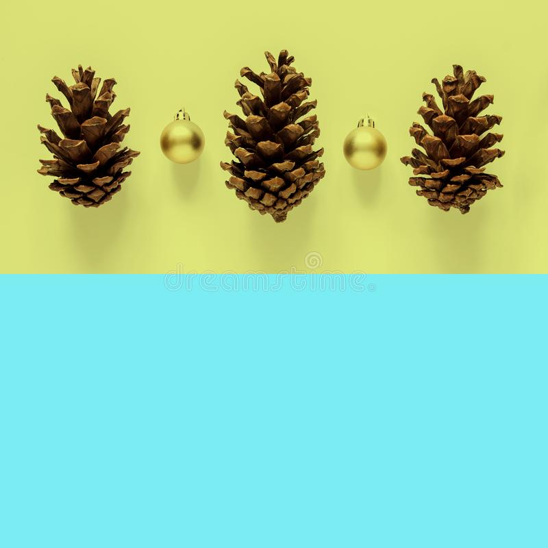 Christmas holidays minimal background. Fir and golden ball on ye royalty free stock images