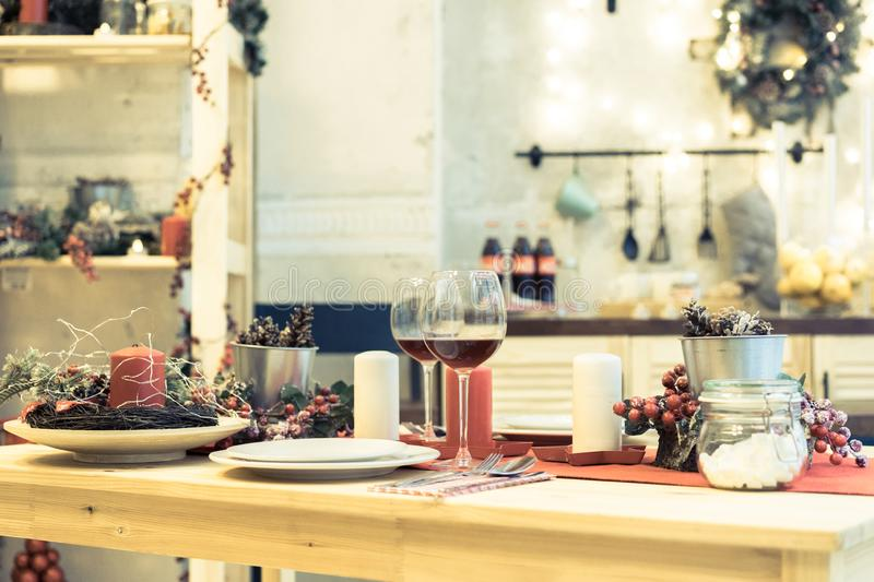 Christmas, holidays and table setting concept - wine glass and t. Ableware for festive dinner at home stock image