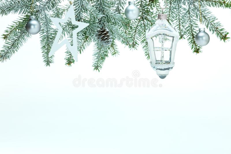 Christmas background with fir tree branch, decorative glass lantern, stars, balls and pine cone. Christmas holidays white background with fir tree branch royalty free stock photos