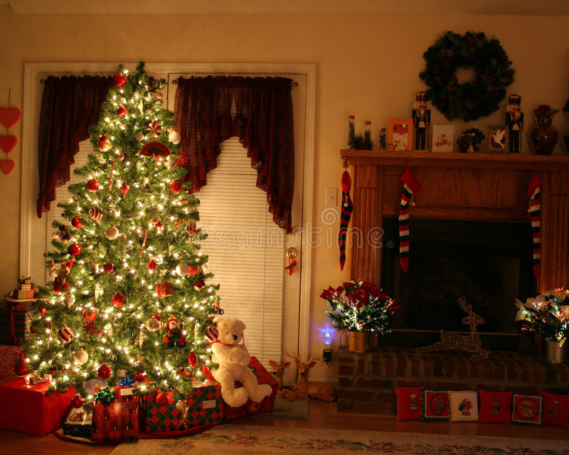 Christmas at home. Home with lighted christmas tree, presents,fireplace,stockings