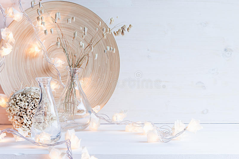 Christmas home decoration with burning lights on white wooden background. stock photos