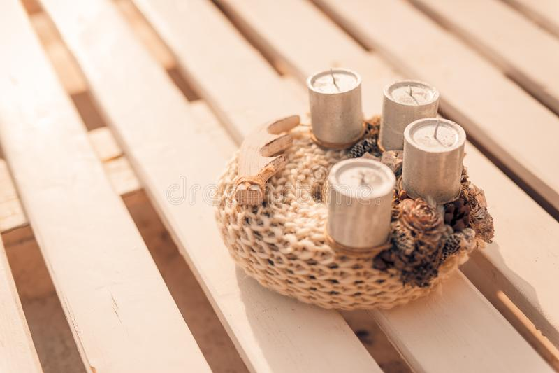 Christmas home decoration. Candles and Xmas sign and wooden decor stock photography
