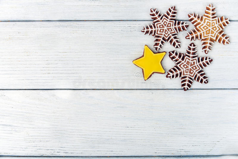Christmas homemade gingerbread cookie over white wooden table stock image