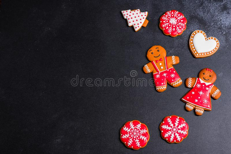 Christmas homemade gingerbread cookies on a dark background stock photo