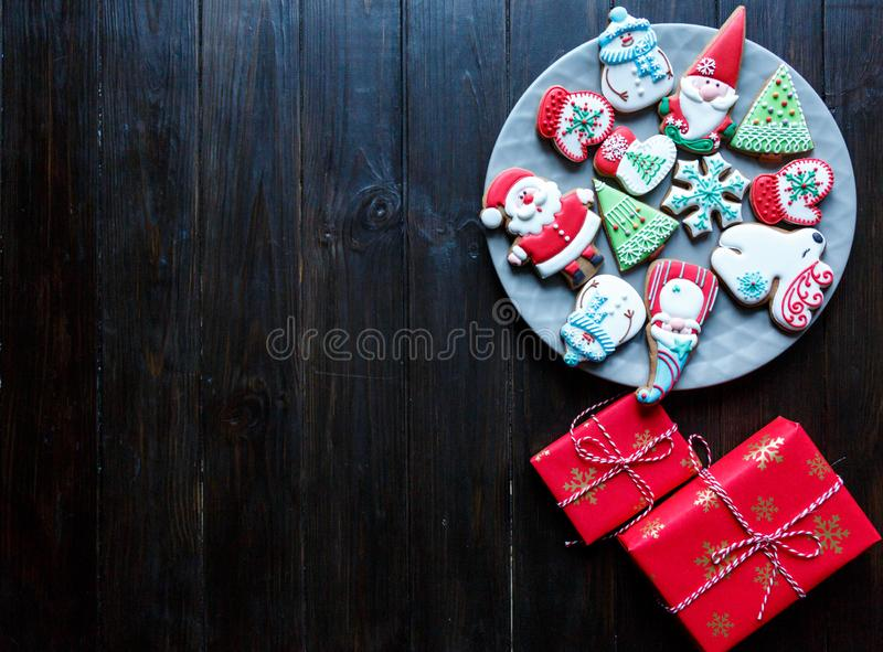 Christmas homemade gingerbread cookies, spices and cutting board on dark background, top view. holiday, celebration and cooking. Concept. new year an royalty free stock photo