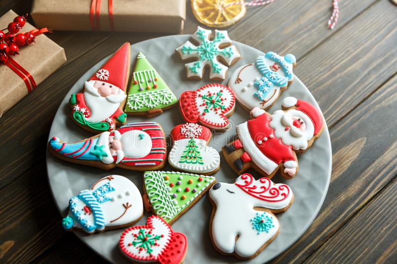 Christmas homemade gingerbread cookies, spices on the plate on dark wooden background among Christmas presents,. Top view. holiday, celebration and cooking royalty free stock photos