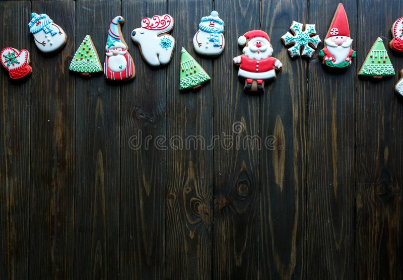 Christmas homemade gingerbread cookies, spices on the plate on dark wooden background among Christmas presents. Christmas homemade gingerbread cookies, on dark stock photography