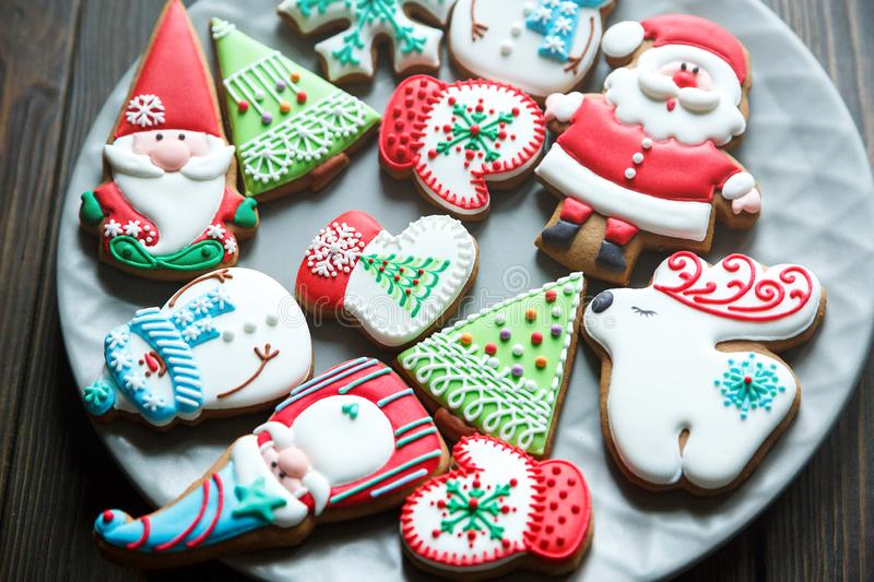 Christmas homemade gingerbread cookies, spices on the plate on dark wooden background among Christmas presents,. Top view. holiday, celebration and cooking royalty free stock photo