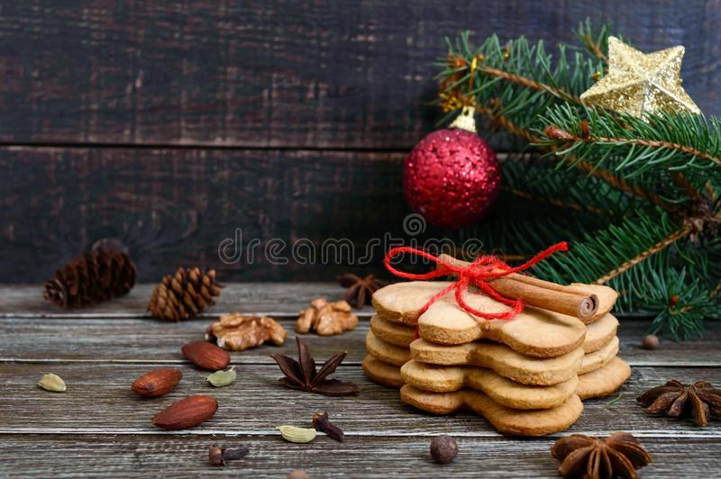Christmas homemade gingerbread cookies and spices on the wooden background. Christmas mood. Happy New Year and Christmas. Holiday royalty free stock photos