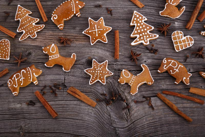 Christmas homemade gingerbread cookies on wooden background stock photo