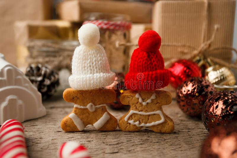 Christmas homemade gingerbread couple cookies on vintage wooden table. Christmas festive closeup. royalty free stock image