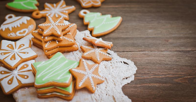 Christmas homemade gingerbread house cookie wooden background stock photography