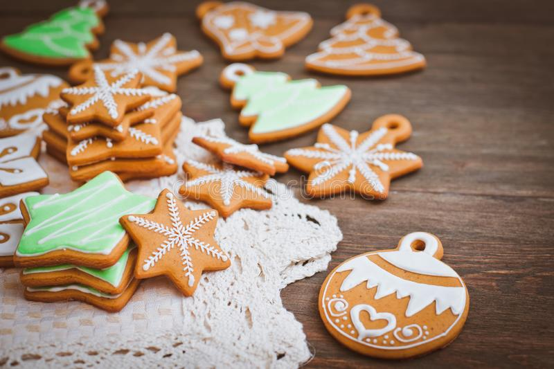 Christmas homemade gingerbread house cookie wooden background stock photos