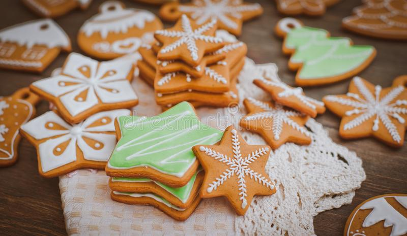 Christmas homemade gingerbread house cookie wooden background royalty free stock photo