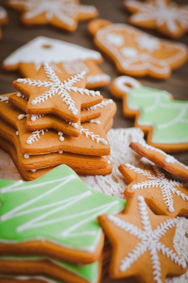 Christmas homemade gingerbread house cookie wooden background stock image