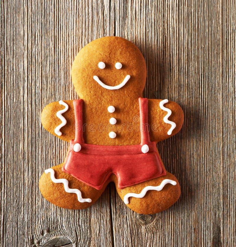 Christmas homemade gingerbread man cookie. Christmas homemade gingerbread man on wooden table royalty free stock photos
