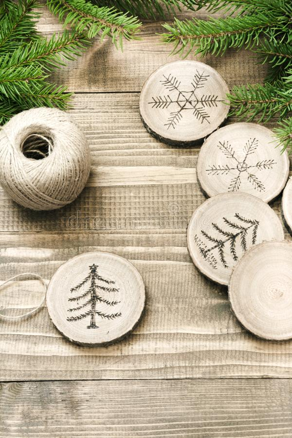 Christmas homemade pyrography toys. Wooden slice. Alternative decor. Christmas decorations. Close up. Christmas or New Year homemade pyrography toys. Wooden stock image