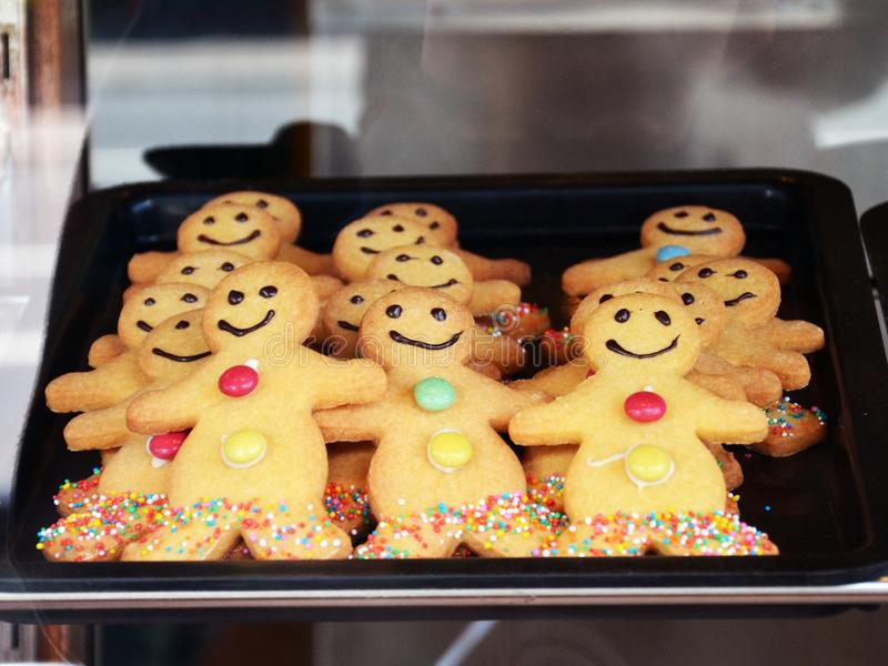 Christmas Homemade Smiling gingerbread man with sugar. Christmas Homemade Smiling gingerbread man, Traditional cookies with icing and candy cane Christmas gift royalty free stock photography