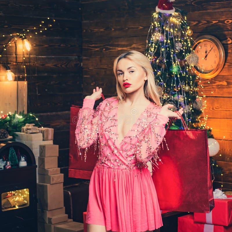 Christmas hoping , sale and discount. Woman with Christmas mood. Sensual girl for Christmas. Fashionable luxury girl stock photos