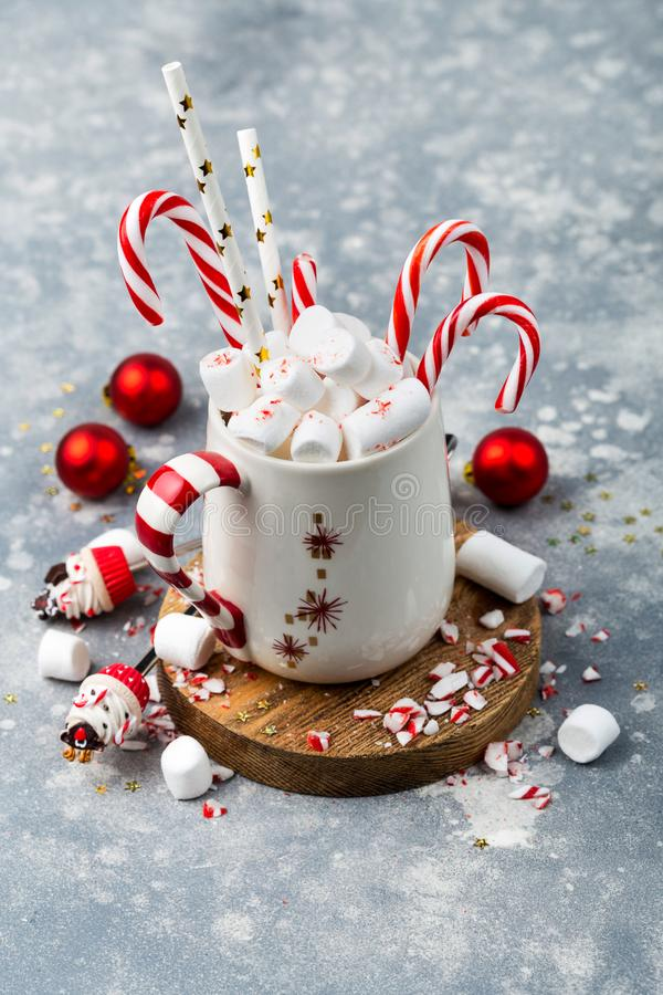 Christmas hot chocolate with candy canes. Christmas composition with hot chocolate decorated with marshmellows and candy canes stock photography